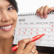 Womwith red felt tip pen and calendar — Stock Photo #11028635