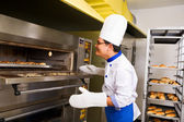 Checking the bread inside oven — Stock Photo
