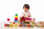 Asian female toddler playing — Stock Photo