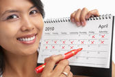 Woman with red felt tip pen and calendar — Stock Photo