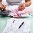 Tax from and woman calculating bills — Stock Photo #11033213