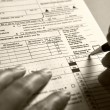 Filling 1040 tax form — Stock Photo