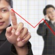 Asian businesswoman pointing graph — Stock Photo