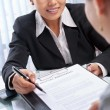 Asian businesswoman explaining document to client — Foto de Stock