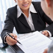 Asibusinesswomexplaining document to client — Stock Photo #11034233