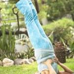 Flexible senior woman doing yoga — Stock Photo