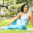Asian senior old woman doing yoga — Stock Photo