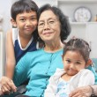 Grandmother and grandchildren at home — Stock Photo