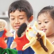 Sibling playing hand puppet — ストック写真