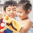 Asian sibling playing hand puppet — Stock Photo #11039502