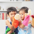Asian sibling playing hand puppet — Stock Photo #11039586