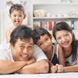 Asian family posing on the floor — Stock Photo #11039724