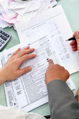 Guiding to fill tax form — Stock Photo