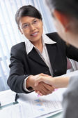 Asian businesswoman handshake with client — Stock Photo