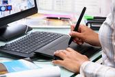 Female graphic designer using tablet pen — Stock Photo