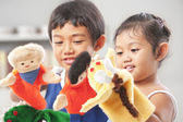 Sibling playing hand puppet — Stock Photo