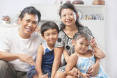Asian family posing at home — Stock Photo