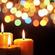 Christmas candle with blurred light - Stock Photo