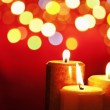 Christmas candle with blurred light — Stock fotografie