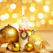 Golden Christmas ornament and candle with blur light — Stock Photo