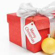 Red Christmas gift with tag — Stock Photo