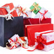 Pile of Christmas present with shopping bag — Stock Photo