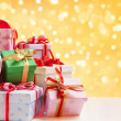 Heap of Christmas gift over blur light — Stock Photo