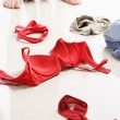 Couple having intercourse with red underwear on floor — Stock Photo #11045511