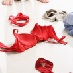 Couple having intercourse with red underwear on floor — Stock Photo #11045511