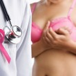 Doctor with pink badge and woman on bra — Stock Photo