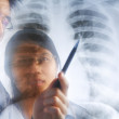 Asian doctors having discussion over xray print — Stock Photo