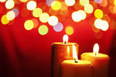 Christmas candle with blurred light — Stock Photo