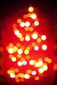 Christmas tree light pattern in blur — Stock Photo