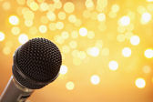 Microphone with blur light — Stock Photo