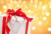 White Christmas present with blank tag — Stock Photo