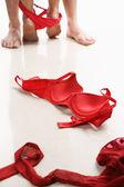 Couple having intercourse with red underwear on floor — Stock Photo
