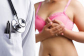 Doctor and woman on pink bra — Stock Photo