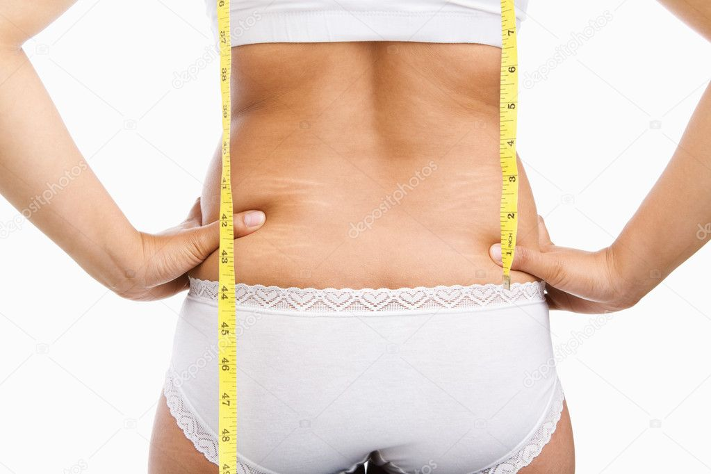 Woman back with cellulite and mesuring tape on under wear over white background — Stock Photo #11045342