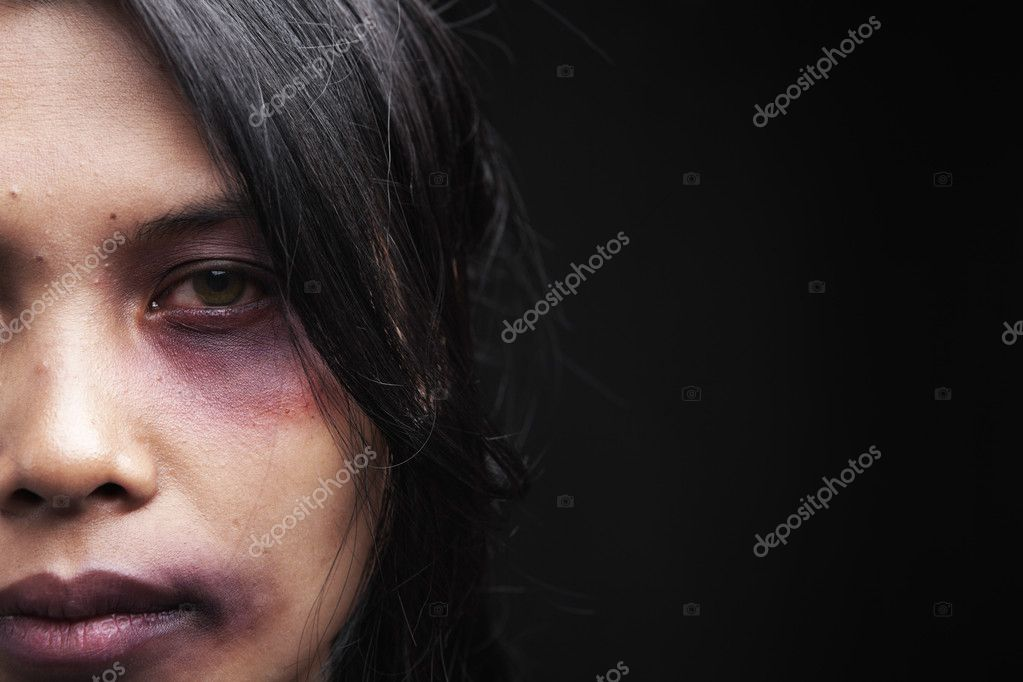Domestic violence victim, a young Asian woman being hurt — Stock Photo #11047947