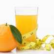 Orange and juice with measuring tape — Stock Photo