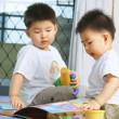 Foto Stock: Brothers playing together