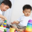 Stock Photo: Brothers playing together