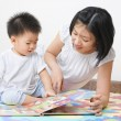 Mother tutoring her son — Stock Photo #11053002