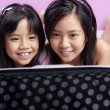 Two little girls playing with laptop — Stock Photo