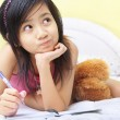 Little girl writing her diary — Stock Photo