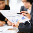 Examining graphs with other on background — Stock Photo