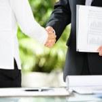 Handshake between businessman and businesswoman — Stock Photo #11055215