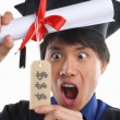 Surprised scholar in expensive education - Stock Photo