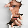 Man looks displeasure from cracked wall — Stock Photo #11056338