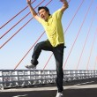 Young man jump with wierd expression — Stock Photo